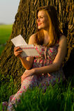 Smiling lady reading letter outdoor Royalty Free Stock Photo