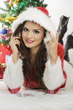 Smiling lady in Santa Claus outfit Royalty Free Stock Image