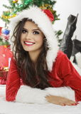 Smiling lady in Santa Claus outfit Stock Photo