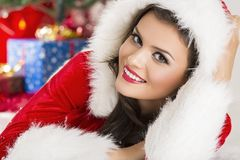 Smiling lady in Santa outfit Stock Image