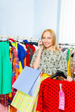 Smiling lady talking on mobile phone in the shop Stock Photos
