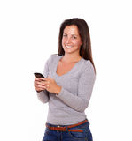 Smiling lady texting on the cellphone Stock Images