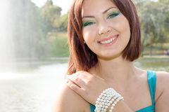 Smiling lady wearing pearls Stock Photos