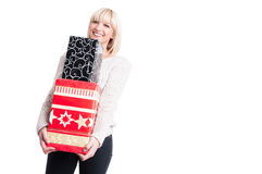 Smiling lady wearing warm sweater holding presents Stock Image