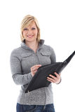 Smiling lady writing in a large folder Royalty Free Stock Photos