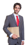 Smiling latin businessman with file Royalty Free Stock Photos