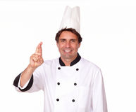 Smiling latin cook in uniform crossing fingers Royalty Free Stock Photo