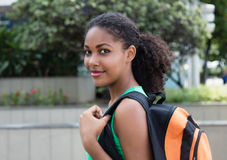 Smiling latin female student with bag in the city Royalty Free Stock Image