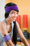 Smiling latin girl at gym Royalty Free Stock Image