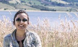 Smiling latin girl stock photos