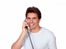 Smiling latin guy conversing on phone Stock Photography