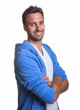 Smiling latin man in a blue jacket Royalty Free Stock Image