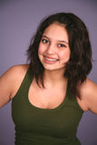 Smiling latina girl with braces. Beautiful hispanic preteen girl with braces in studio Royalty Free Stock Photography