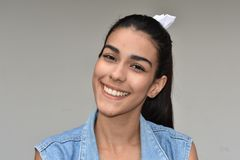 Smiling Latina Teen Female. A pretty young Colombian teen girl stock image