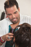 Smiling Latino Hairdresser Royalty Free Stock Image