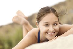 Smiling Latino Woman lying down on Beach Stock Photos