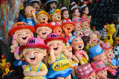 Smiling and laughing clay doll stock images