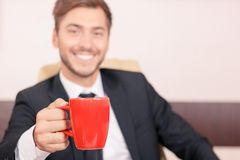 Smiling lawyer drinking tea Royalty Free Stock Image