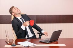 Smiling lawyer drinking tea Royalty Free Stock Photography