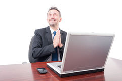 Smiling lawyer winking and praying Royalty Free Stock Images