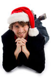Smiling laying male wearing christmas hat Stock Photo