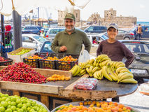 Smiling Lebanese greengrocers. Happy greengrocers in the city street market in Sidon, Lebanon Royalty Free Stock Images
