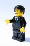 Smiling lego businessman offering handshake Stock Images