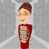 Smiling librarian with glasses holding books Royalty Free Stock Photography