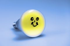 Smiling Light bulb Stock Images