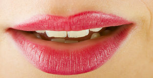Smiling lips with lipstick Stock Photos
