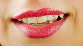 Smiling lips with lipstick Stock Image