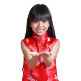 Smiling little asian girl with cheongsam respecting Royalty Free Stock Photo