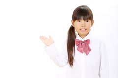 Smiling little asian schoolgirl Royalty Free Stock Photos