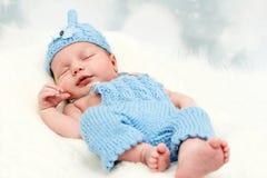 Smiling little baby born. Studio portrait of newborn baby Royalty Free Stock Photos