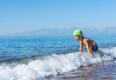 Smiling little baby boy green baseball cap playing in the sea. Positive human emotions, feelings, joy. Smiling little baby boy in green baseball cap playing in royalty free stock photo