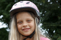 Smiling little  bicyclist girl Stock Images
