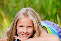 Smiling little blond girl stock photography