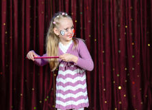 Smiling little blond girl wearing pantomime makeup Royalty Free Stock Images
