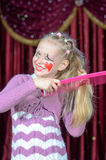 Smiling little blond girl wearing pantomime makeup Royalty Free Stock Photos