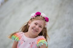 Smiling little blonde girl. Portrait of happy cheerful beautiful young girl, outdoors. Copy space Stock Photo