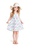 Smiling little blonde girl wearing big white hat and dress. Over white background Royalty Free Stock Image