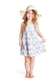 Smiling little blonde girl wearing big white hat and dress Stock Image