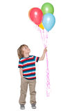 Smiling little boy with balloons Royalty Free Stock Photos
