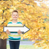 Smiling little boy with blank arrow pointing right Stock Images
