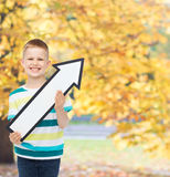 Smiling little boy with blank arrow pointing right Stock Photography