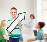 Smiling little boy with blank arrow pointing right Stock Photos
