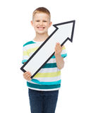 Smiling little boy with blank arrow pointing up Royalty Free Stock Image