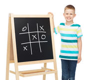 Smiling little boy with blank blackboard Stock Photos
