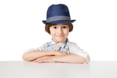 Smiling little boy in the blue hat Stock Image