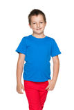 Smiling little boy in the blue shirt Royalty Free Stock Photography